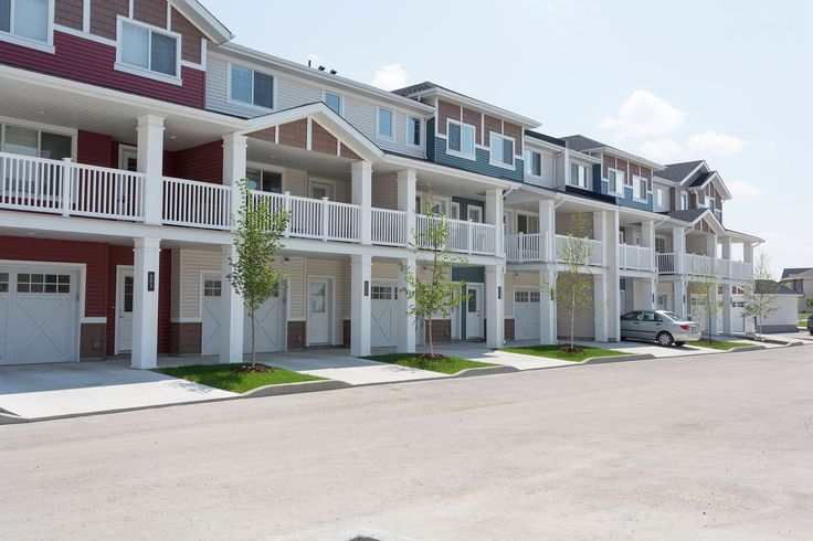 Our two story townhomes with garages.  #exteriorcolours #landscaping #townhouse #colour
