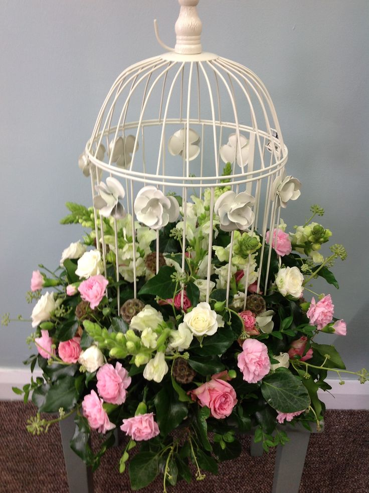 One of our stunning birdcages filled with country garden flowers ... They make gorgeous table centres