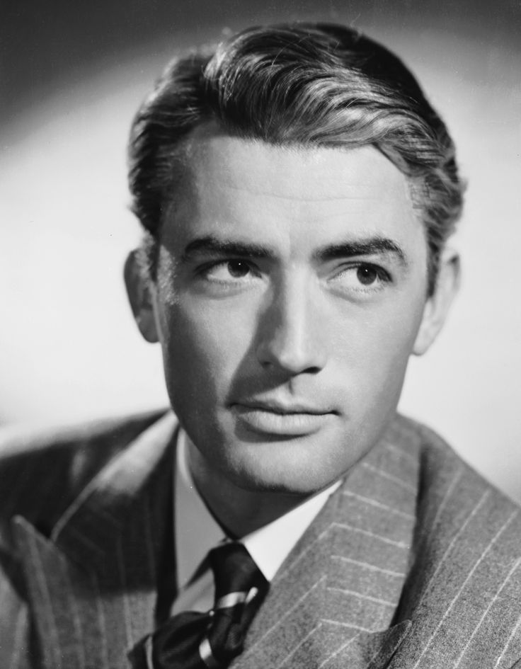 Dark haired and stoic?  Hell yeah. (Gregory Peck)