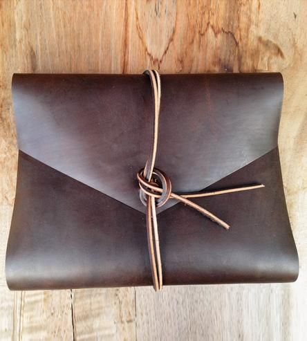 "This hand cut leather binder would be a great gift for some one that ""has it all"". {Leather Portfolio Binder made by Hunter Pass, available on Shoppe}"