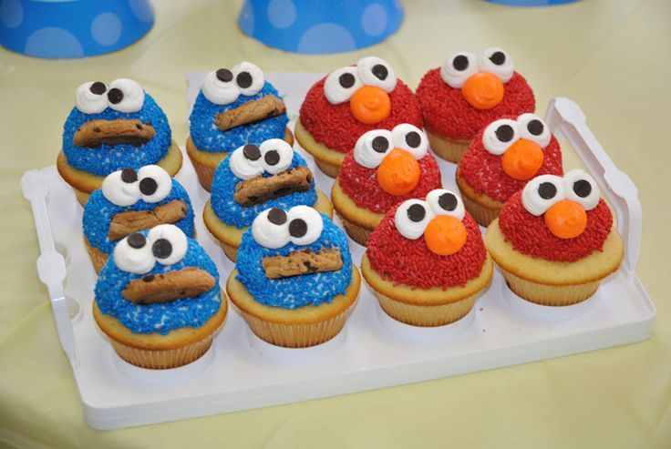 Elmo and Cookie Monster cupcakes Cute! :)