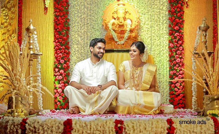 Indian wedding photography. Couple photo shoot ideas. Candid photography. Traditional Southern Indian Malayalee bride wearing bridal silk saree, jewellery and hairstyle. Kerala Wedding Styles