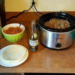 Slow Cooker Machaca - Allrecipes. - a pork roast and a beef roast cooked together shred and add green enchilada sauce and green chilies and cook some more