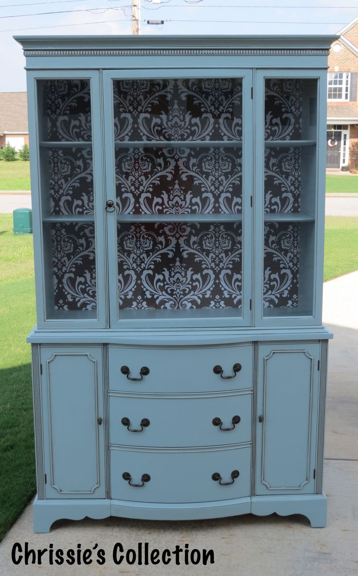 Damask china cabinet by Chrissie's Collection. Painted in General Finishes Persian Blue.
