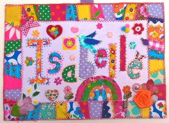 Hi, this is a unique personalised beautiful gift for a child, A very fun, pretty and colourful A4 sized wall hanging.  Each piece is made to order and packed full of charming and fun little details and embelllishments plus a lovely patchwork edging.  The one shown here for Isabelle includes her favourite colours and a rainbow, birds, hearts and flowers because that is what she asked for!  The second one shown is for Mimi and she likes flowers, birds and owls.  I have attached a hanging loop…