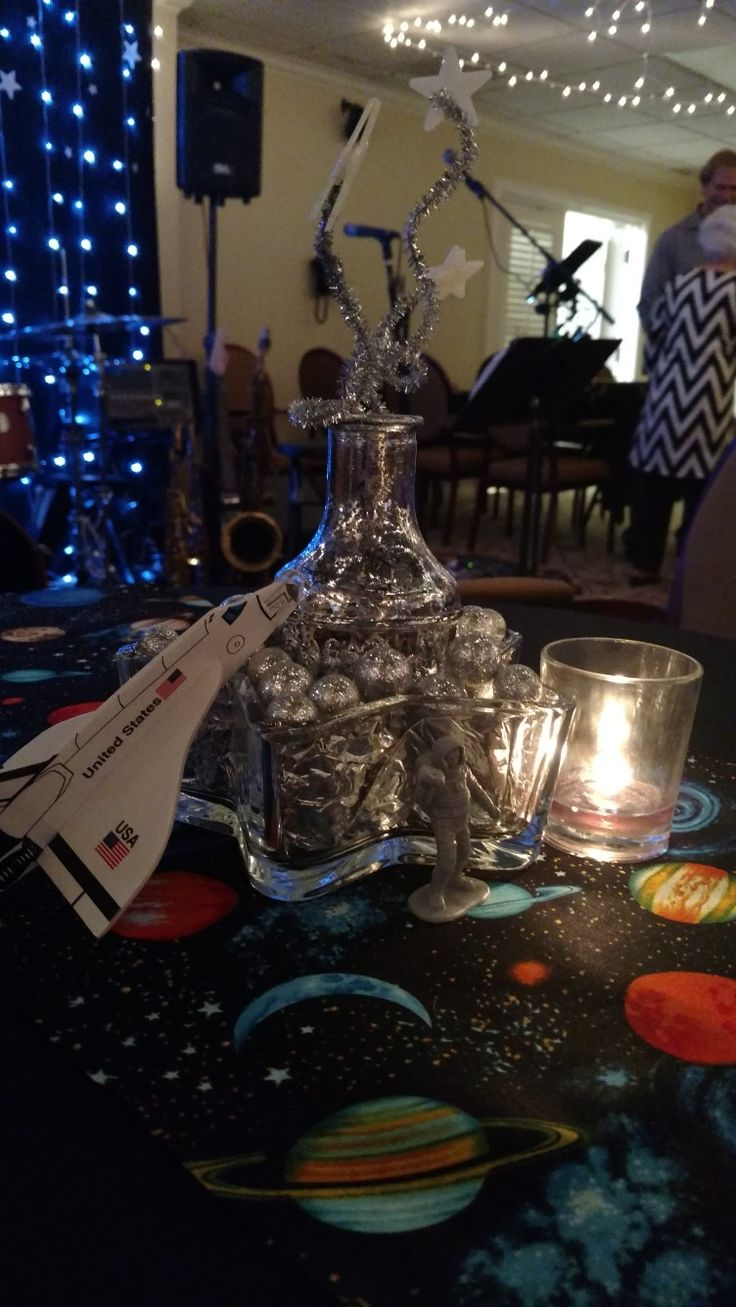 Space Theme Party Decor #silver #glitter #nasa #usa #glowinthedark #planets #candle #stars #outofthisworld #outerspace #pipecleaners #astronauts #adultparty #party #decor #centerpiece #tabledecor