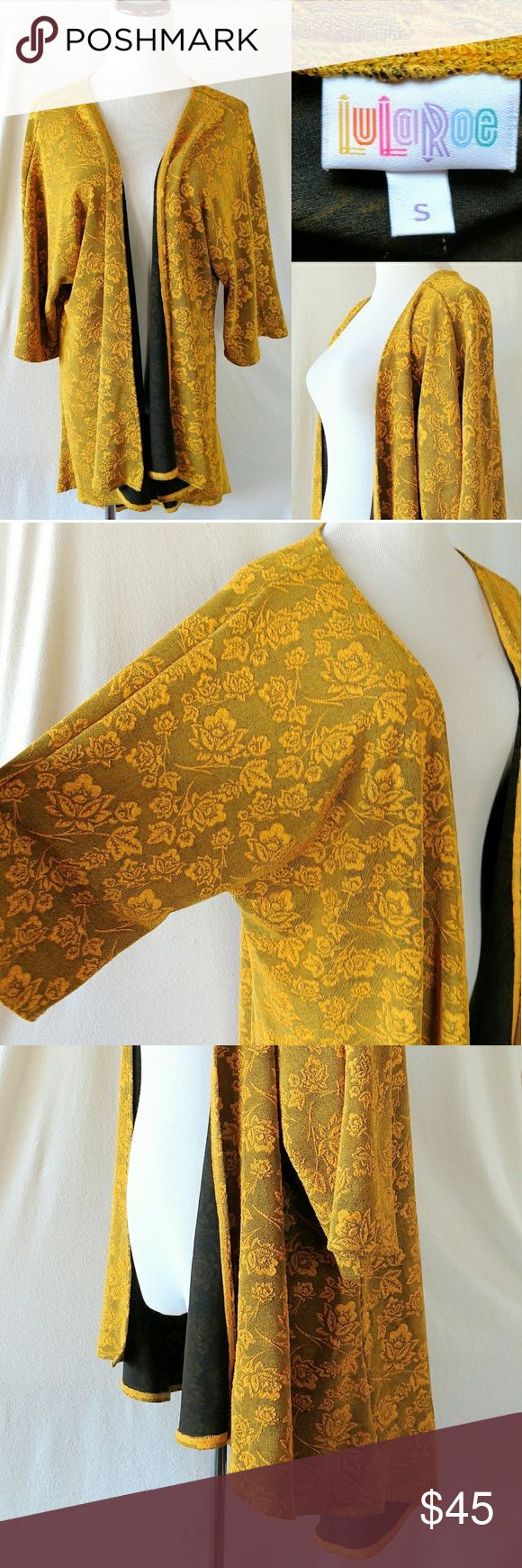 LuLaRoe Yellow Gold Lindsay Kimono Jacket Small This Lindsay is a beautiful mustard yellow and is made of a thicker material which makes it hang perfectly!  Looks fantastic with lots of leggings!  Tags: Lularoe, Lindsay, Lindsey, yellow, gold, mustard, flowers, jacquard, thick, warm, kimono, open jacket, s, small, roses, free shipping LuLaRoe Jackets & Coats