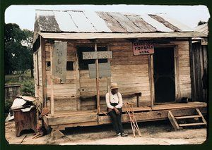 Store with live fish for sale, near Natchitoches, Louisiana, taken in July 1940