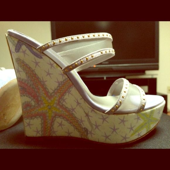 """🎀SALE🎀Amazing VERSACE Starfish Wedge Heels!!! Practically New!! worn x 2 for a couple hours. These shoes are mint & they are amazing!! Gorgeous colors, perfect for summer with lilac, pink, gold, cream, etc etc. they are a platform wedge (5"""" heel with 1 1/2"""" Platform) so comfortable & VERY hard to find!! They have double mesh straps  with gold studs across the feet & a plated back heel for that extra pop and to protect the fabric. These shoes would NEVER leave my closet if they were 1 size…"""