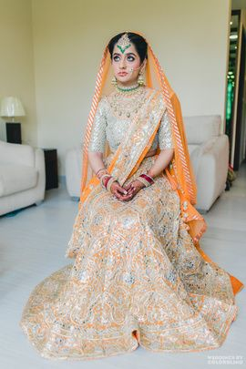 Bridal Lehengas - Gursimran & Meher wedding story | WedMeGood | Red and Silver Wedding Lehenga with a Net Orange Dupatta  #wedmegod #indianbride #indianwedding #bridal #orange #summerwedding #lehenga #weddinglehenga