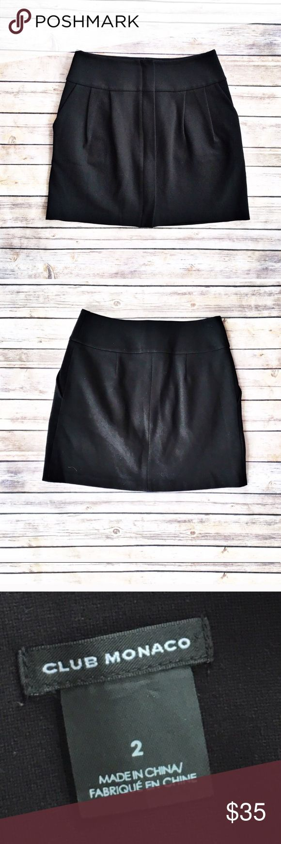 """Club Monaco black ponte skirt Elegant black ponte skirt with pleating and pockets, size 2 from Club Monaco. Fold over flap conceals full front zipper. Excellent condition. Flat measurements are waist 14.5"""", hips 19"""", length 16"""". Club Monaco Skirts Mini"""
