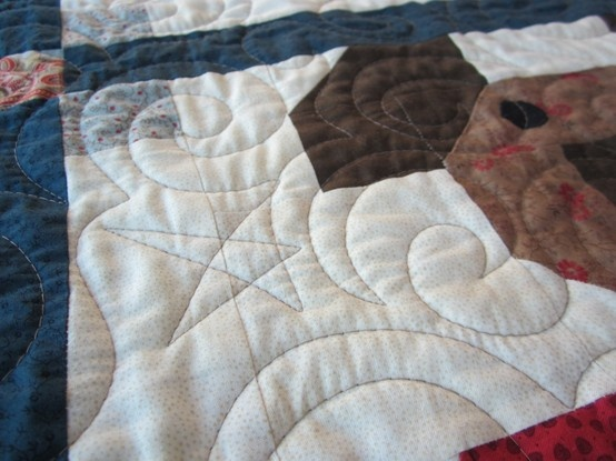 A Close up of the quilting design on Teddies Quilt. The quilting was done by my friend at http://vicaragequilts.blogspot.co.uk