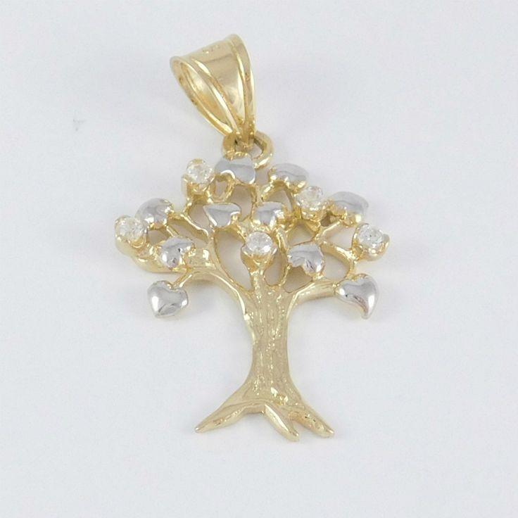 Sárga és fehérarany kombinációjú életfa medál    Súly: 2,2 g    Hossz: 2 cm    Sárga és fehérarany kombinációjú életfa medál, kövekkel foglalva