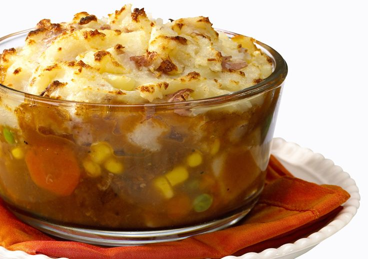 Mashed potatoes baked on top of the HMR Vegetable Beef Stew Entrée? Count us in! This is just some good old-fashioned comfort food.   Ingredients 1 HMR Vegetable Stew with Beef Entree 1-2 red potatoes (8 oz. total) ½ cup corn ¼ cup broth (vegetable, beef, or chicken) Butter substitute to tas