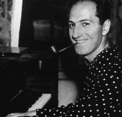 "George Gershwin. At 25, his jazz- influenced ""Rhapsody in Blue"" premiered in New York. His best known works include ""An American in Paris"", ""Cuban Overture"" and ""Lullaby for Strings"", as well as ""Porgy and Bess"", which included ""Summertime"". Unfortunately, at the young age of 38, he died of a brain tumor. Who knows what other beautiful music he would have created…"