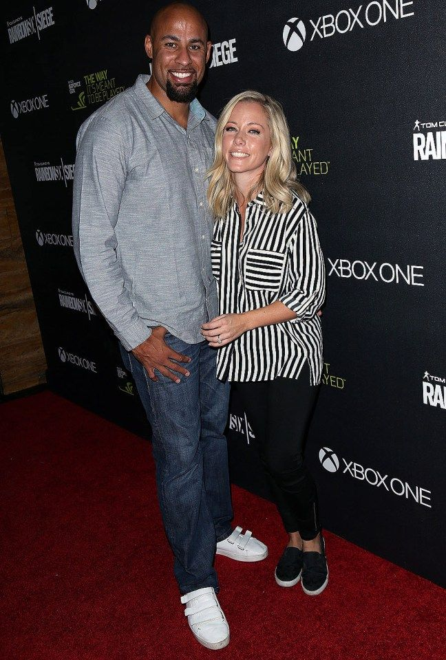 "Hank Baskett and Kendra Wilkinson put on a united front at the ""Rainbow Six Siege"" launch in Los Angeles on Monday."