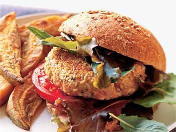 Guiltless Salmon Burger Healthy wild salmon doubles for beef in this burger, which contains about ten fewer grams of fat than the traditional beef version, and weighs in at 346 calories (with the whole grain bun).   Recipe:Guiltless Salmon Burger