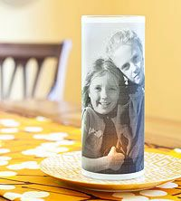 Make a Photo Candle Holder: Here's proof that your child's smile can literally light up a room-with the help of a battery-operated tea light.