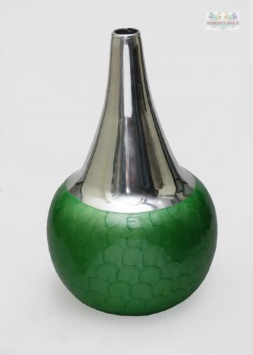 Accentuate the contemporary look of your home decor with this Green colored vase. Sleek and attractive, this vase is made of finest quality. The bright color makes the vase look very beautiful when decorated tastefully and is perfect for gifting purpose.
