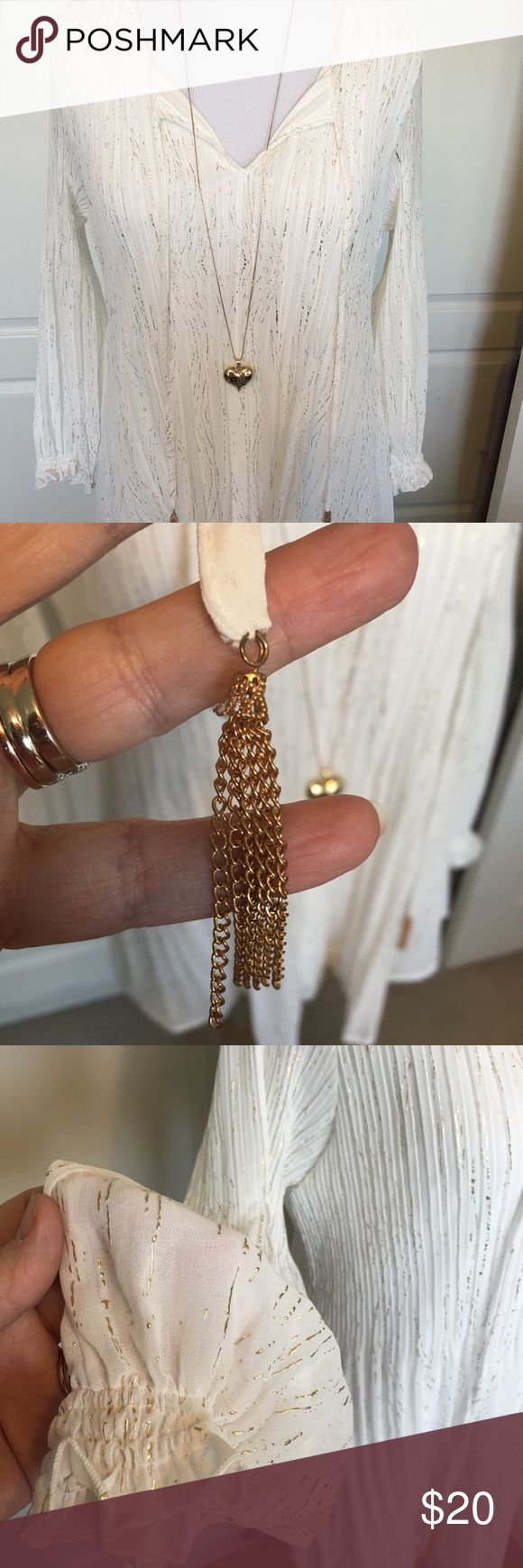 """🆕Melissa Paige Woman white and gold tunic This beautiful tunic has a fully lined bodice for modesty and measures 30"""" long.  There is a chain detail on the end of the ties and metallic gold throughout. melissa paige woman Tops Tunics"""