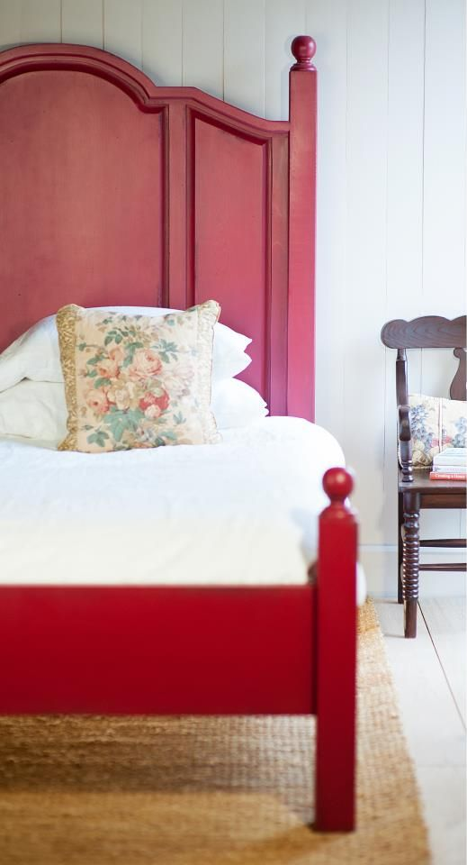 In love with this red farmhouse bed! Third floor spindle bed