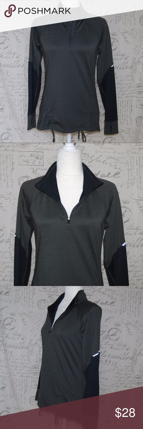 """Lucy Athletic Gray 1/2 Zip Pullover Sweater Small Lucy Athletic Women's Gray 1/2 Zip Pullover Sweater Small Thumbhole sleeves Drawstring bottom front Reflective strip on arm Piling from normal wash and wear.  Measurements taken with garment flat on table. Armpit to armpit: 17"""" Sleeves: 27.5"""" Length: 23.5"""" Lucy Sweaters"""