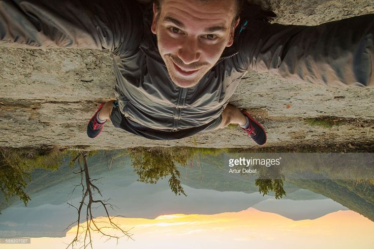 Stock Photo : Taking a selfie up side down on the nature
