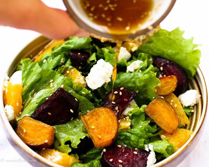 Roasted Beet Salad with Orange Citrus Vinaigrette and Goat Recipe Salads with golden beets, red beets, orange, olive oil, sea salt, cane sugar, goat cheese, lettuce, rice vinegar, orange juice, olive oil, chopped fresh mint, dijon mustard, minced garlic, honey