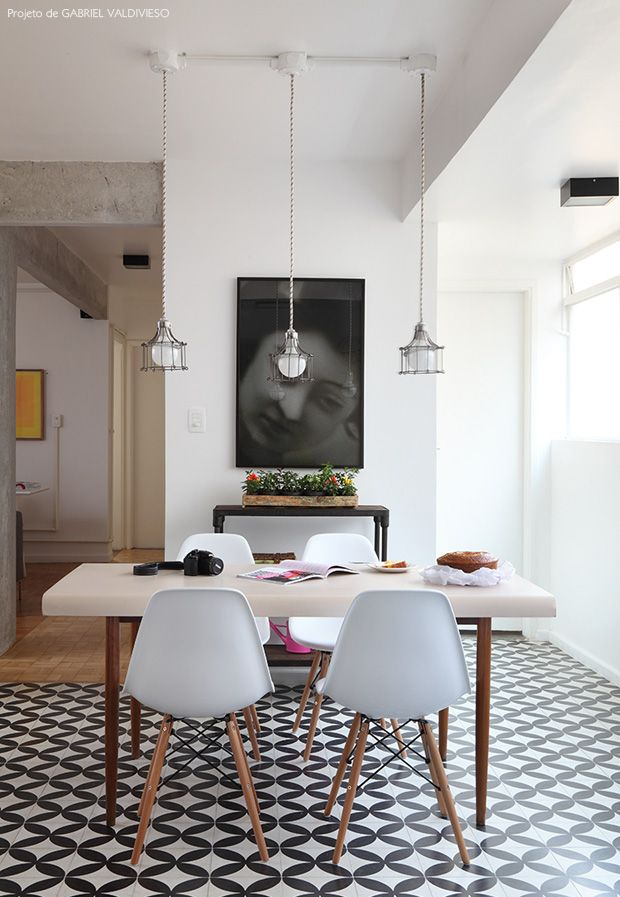 dining room is integrated into the social area with industrial Lamps