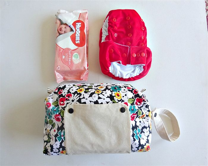 Vintage flower pattern modern cloth nappy bag. nappy wallet. now available in store.  Can also be used for disposables which means there is room for a change of clothes or a bib and burp cloth