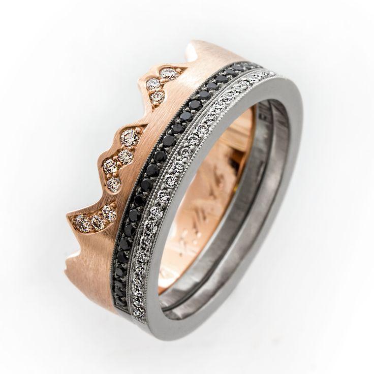 Unique wedding ring set. Rose gold, white gold, titanium and black and white diamonds!