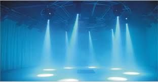 these stage lights show how that there is more than one person performing and they all have there own spot light (stage lighting - Google Search)