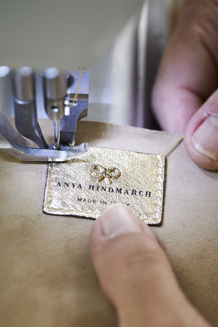 Stitching the embossed leather Anya Hindmarch logo