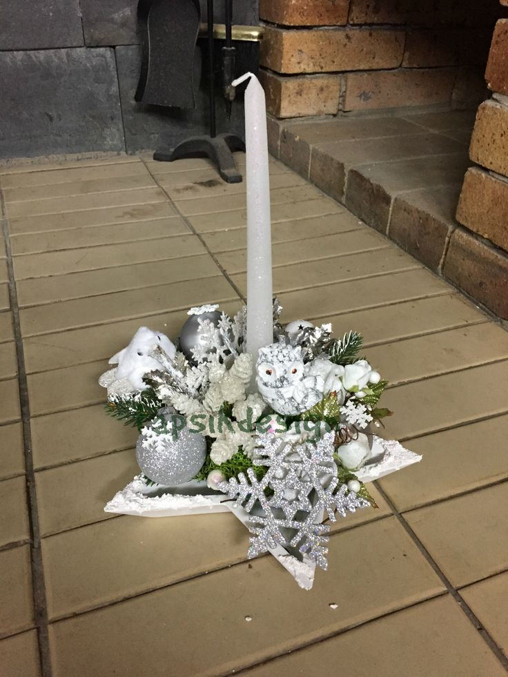 Candle holder decoration. In the color white-silver. Base wooden star. Added artificial greenery, christmas ornaments, owl, bird, snowflakes.