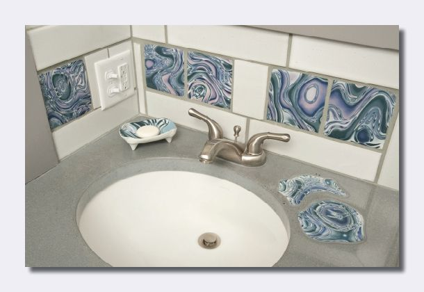 Colored clay tiles for the bathroom or kitchen are only a few of the kinds of clay work that Naomi Lindenfeld does.