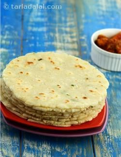 Rice flour combined with cooked left-over rice can be used in many surprising and novel ways. I have used this combination to prepared delicious rotis. To perk up their flavour garlic, ginger and green chillies are added. Curds are added to make the rotis soft. This is a good way to make use of left-over rice. Serve these hot with a spicy pickle.