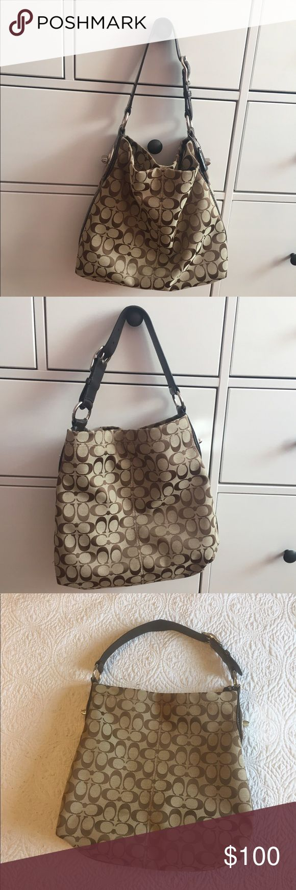 ⭐️ COACH ⭐️ Tan/Brown Signature Shoulder Bag ⭐️ ⭐️ COACH ⭐️ Tan/Brown Signature Should Bag • good condition • Zip, cell and multifunction pockets • strap shaped from storing on closet hook ‼️open to offers‼️ Coach Bags Shoulder Bags