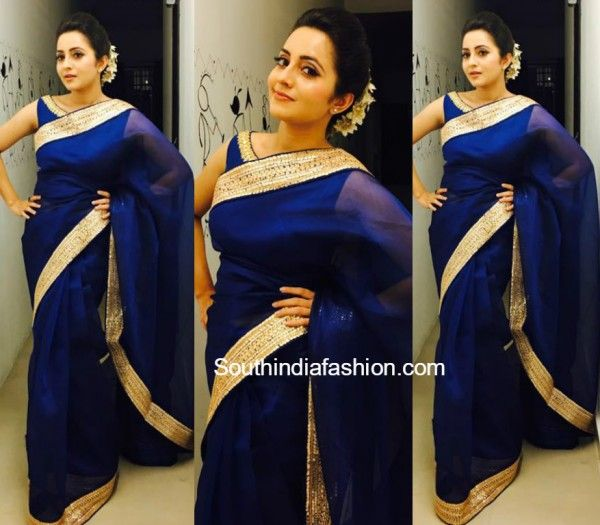 Bhama in a blue chanderi silk saree featuring gold gota patti border paired with matching boat neck blouse.