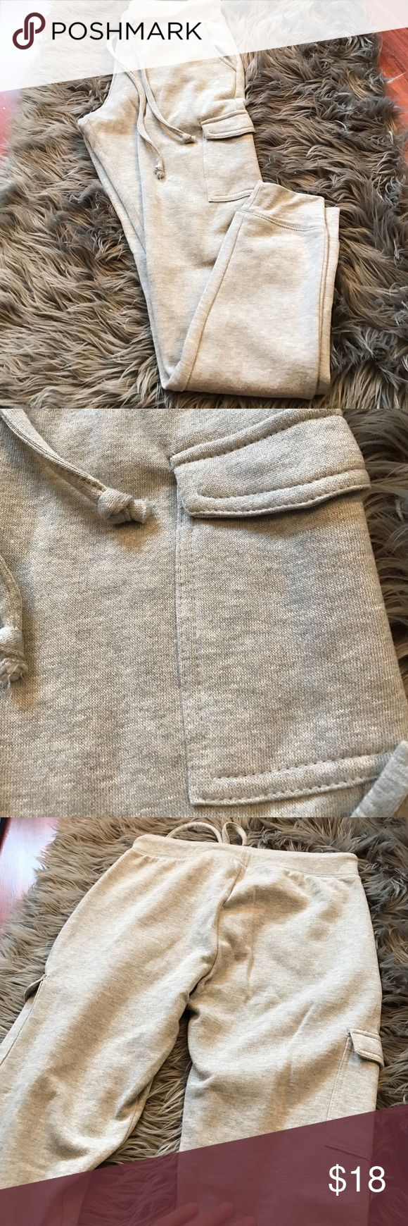 Gray cargo joggers All gray women's cargo joggers! They're a size medium but run small! They've never been worn before so are in excellent condition. They have a soft inside. Make an offer 😊 Wet Seal Pants Track Pants & Joggers