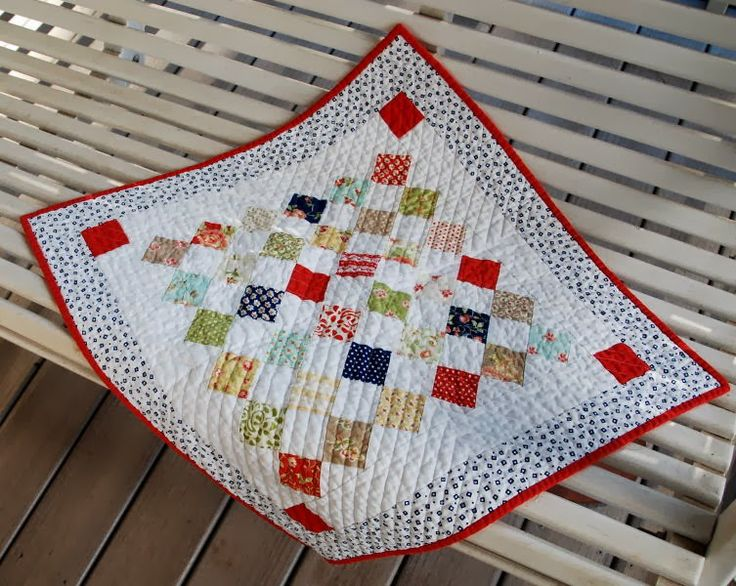 A Quilting Life - a quilt blog. Table topper made with one pack of Moda Candy squares (or 40 squares)