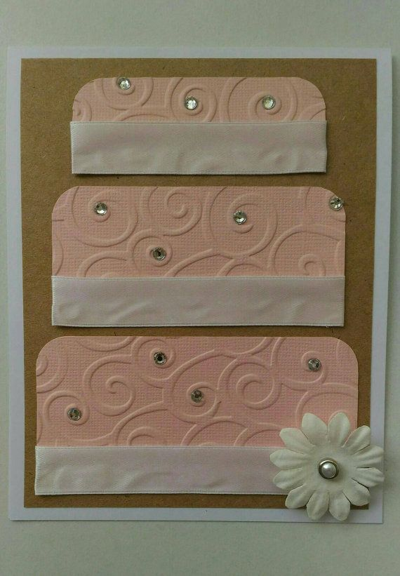 WEDDING CAKE: a beautiful and delicate card featuring a large pastel pink wedding cake, decorative white flower and silver diamontes.  Measurements: