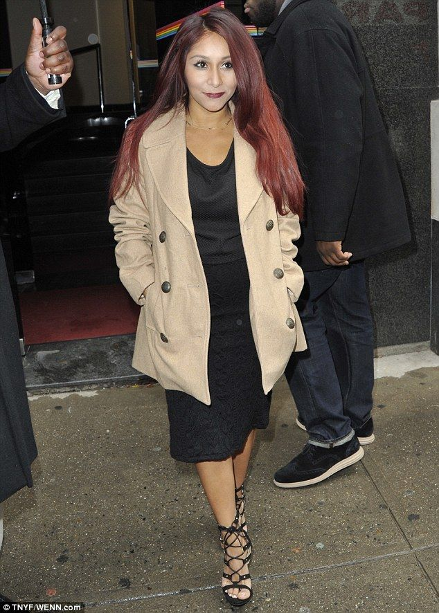 Simply chic: The reality star unveiled her elegant side in a beige coat,  midnight