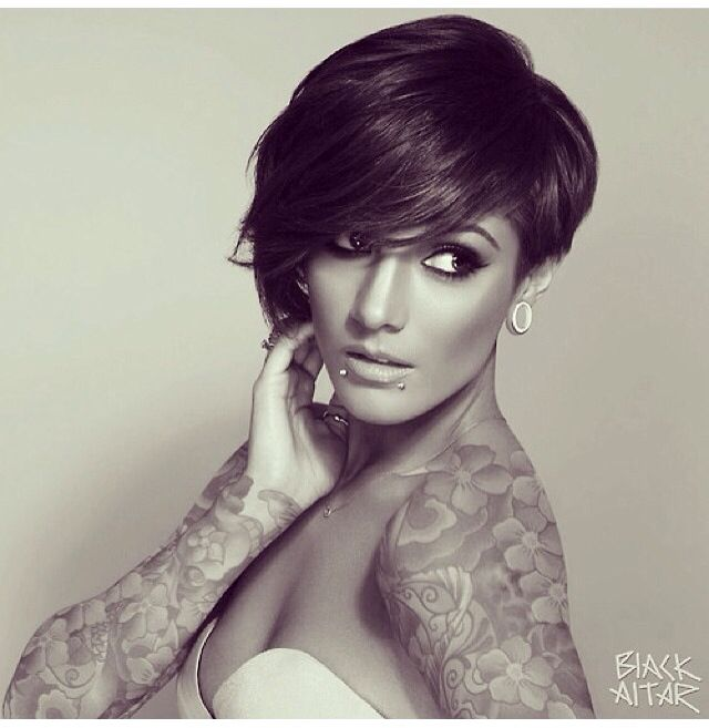 Asymmetrical pixie. The pic is super photoshopped if that's Frankie Sanford. She doesn't have gauges, snakebites, or tattoos. But the hair is perfect.