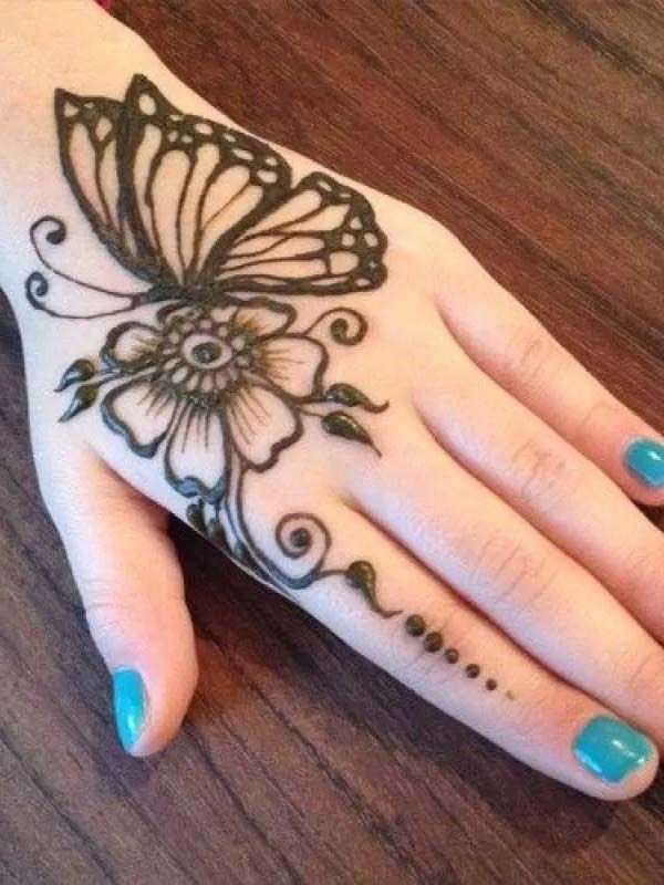 Girls Backhand Is Decorated With This Latest Butterfly Mehndi Design To Give A Stunning Mehndi Designs For Hands Back Hand Mehndi Designs Latest Mehndi Designs