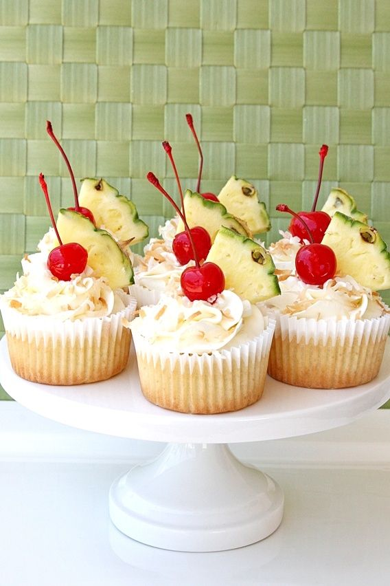 Pina+Colada+Cupcakes+with+Coconut+Cream+Cheese+Frosting    Pineapple+Cupcakes  (recipe+by+Glorious+Treats)    2+1/2+cups+flour  1+1/2+teaspoons+baking+powder  1/2+teaspoon+baking+soda  1/2+teaspoon+salt  3+eggs  1+3/4+cups+sugar  1+cup+vegetable+oil  1+teaspoon+vanilla+extract  3/4+cup+sour+cream  1+1/2+cups+canned+crushed+pineapple+(drained+slight