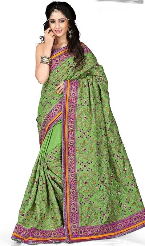 Become the epitome of understated elegance draping this green color embroidered manipuri silk saree. You could see some interesting patterns done with lace and resham work. Upon request we can make round front/back neck and short 6 inches sleeves regular sari blouse also. #LightGreenColorOfEmbroideredSari