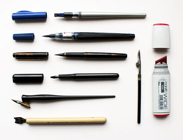 Seb Lester's recommended tools (from top to bottom): Pilot Parallel Pen, Pentel Colour Brush, Kuretake No. 13 Fountain Brush Pen, Manuscript Italic Fountain Pen, Nikko G Nib with oblique pen holder, Automatic Pen, Ruling Pen, Copic Wide Marker.