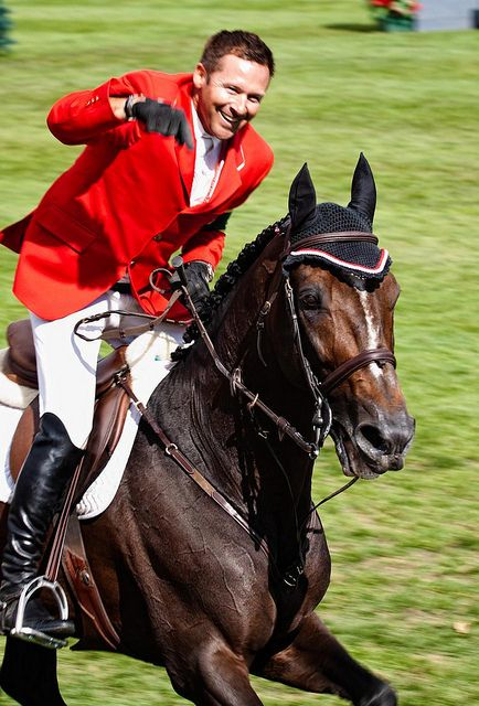 Hickstead and Eric Lamaze, Spruce Meadows 2011 by Erin Butler, via Flickr