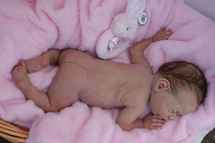 Full silicone body reborn. Amazing little body. Loving those wrinkles!