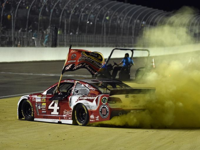 Kevin Harvick does a burnout after winning the Ford